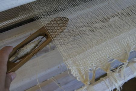 Weaving With Shuttle In Hand